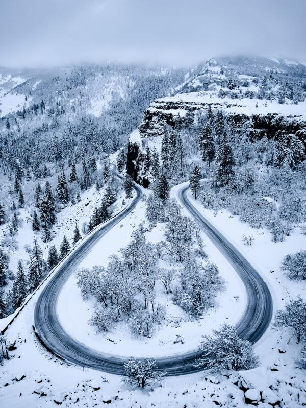 tips for driving in the snow - handle hills and curves