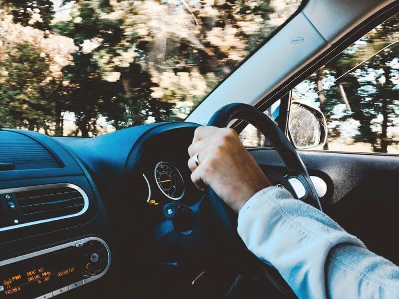 tips to stay awake while driving - take rest on the road